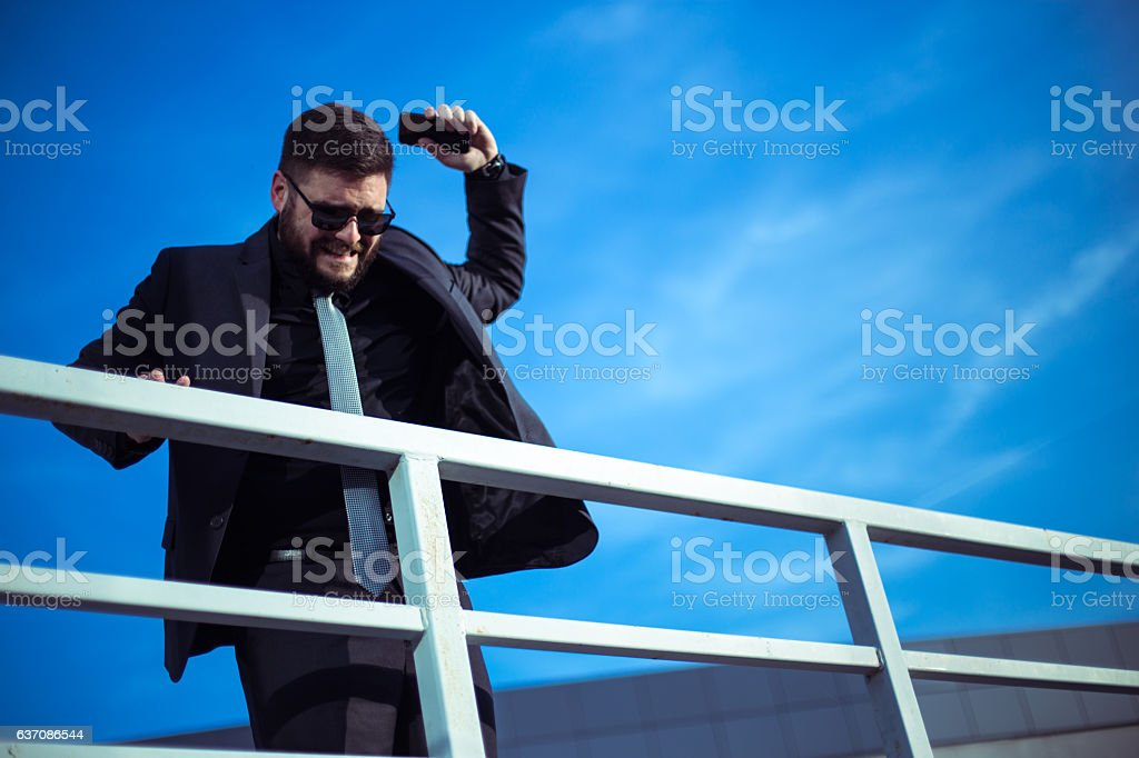 Angry businessman throwing phone stock photo