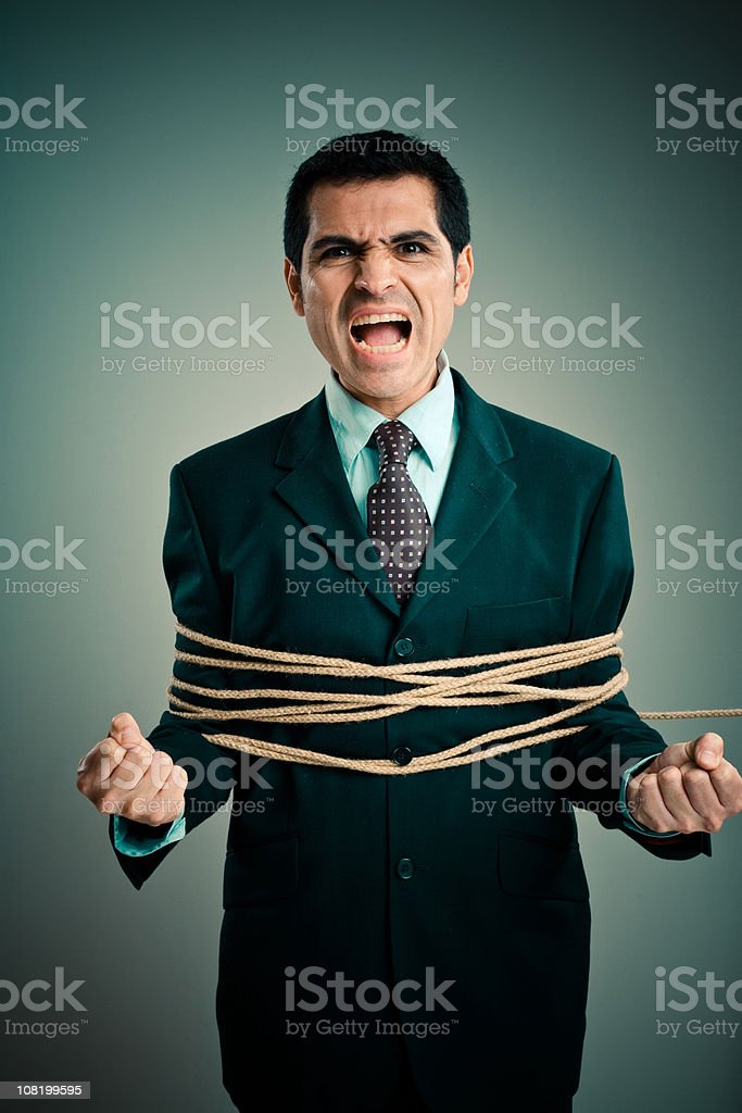 Angry Businessman Tied up with Rope royalty-free stock photo
