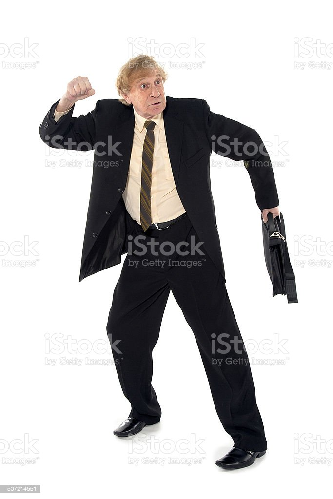 Angry businessman wants to hit stock photo