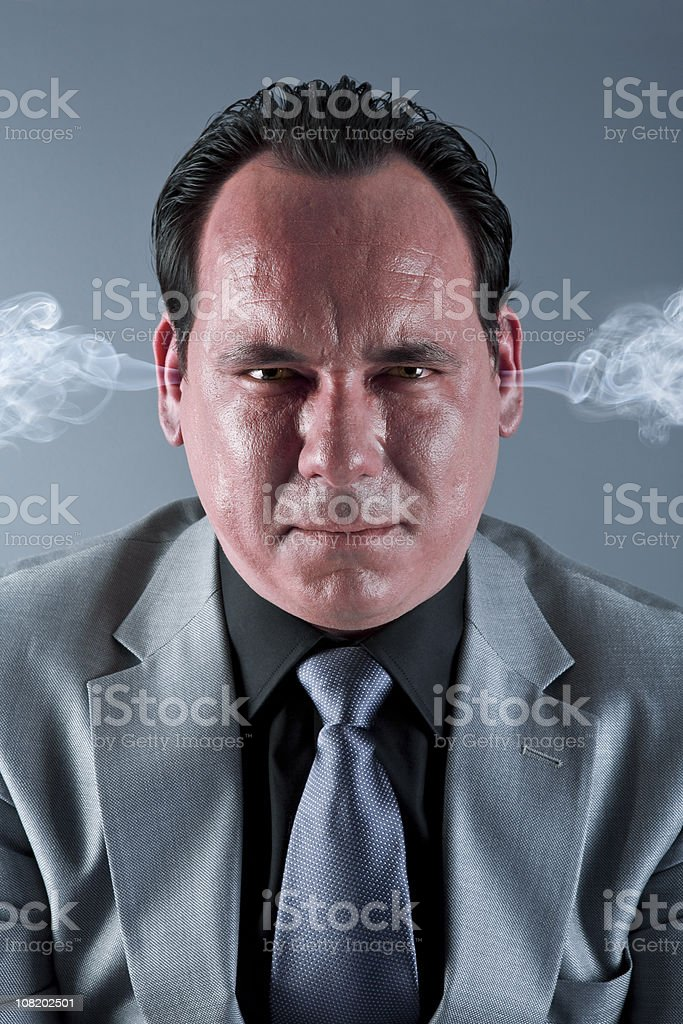 Angry businessman with steam coming from ears royalty-free stock photo