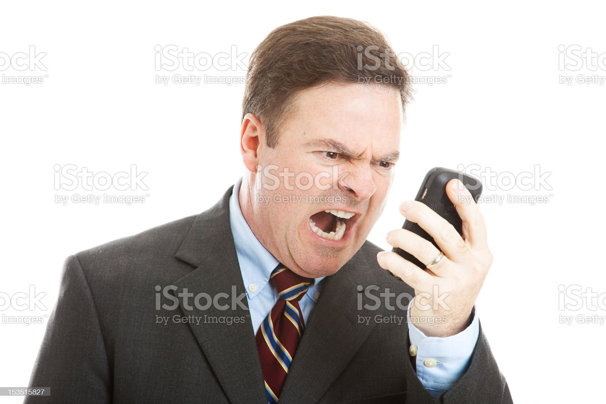 Angry Businessman Yelling into Phone royalty-free stock photo