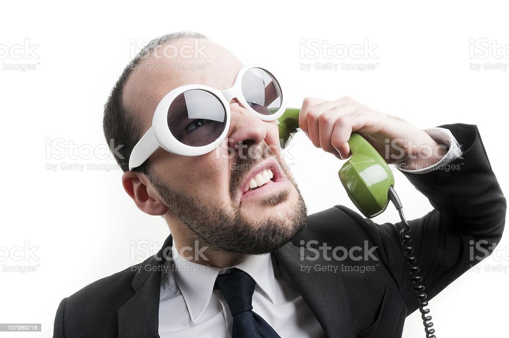 Angry businessman on the phone royalty-free stock photo