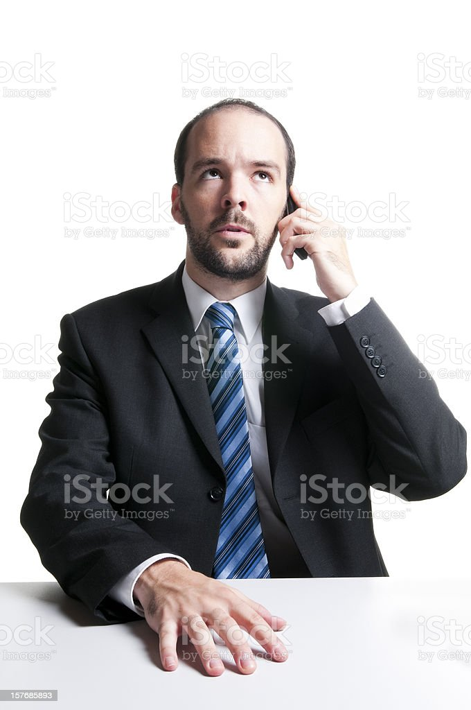 Angry businessmanon the phone, thinking stock photo
