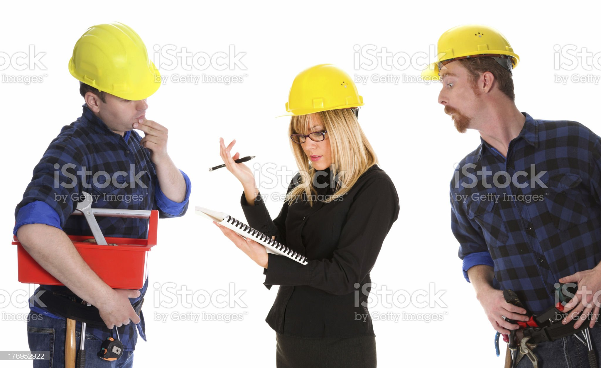 angry businesswoman and construction workers royalty-free stock photo