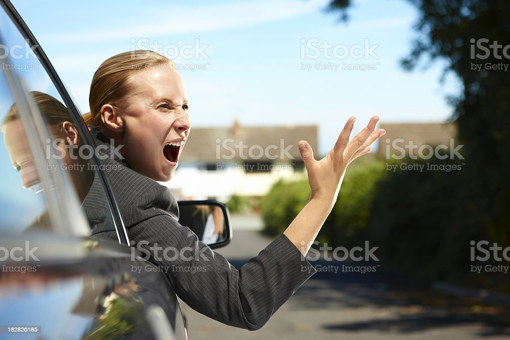 angry businesswoman in car screaming at another driver stock photo