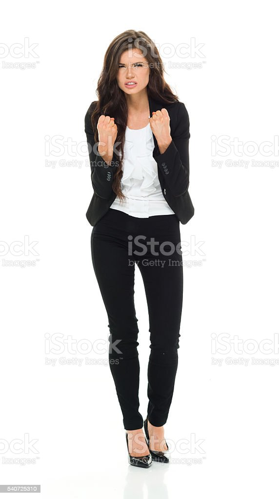 Angry businesswoman in fighting stance stock photo