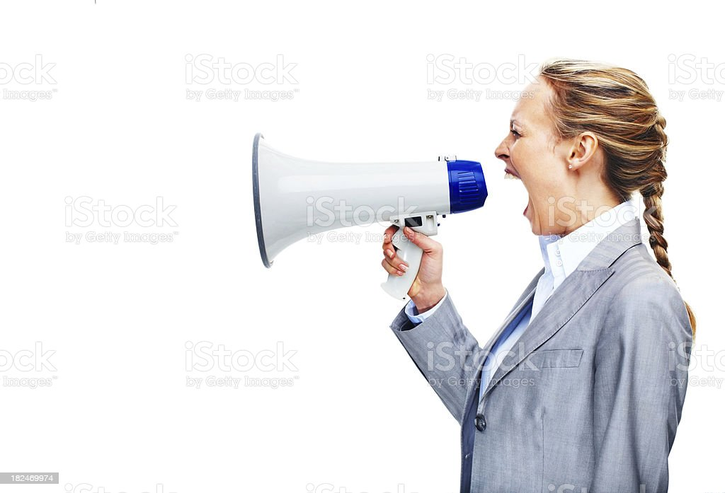 Angry businesswoman screaming into a megaphone stock photo