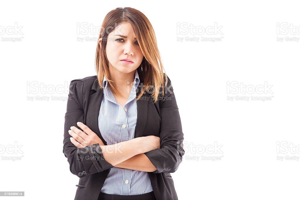 Angry businesswoman with arms crossed stock photo