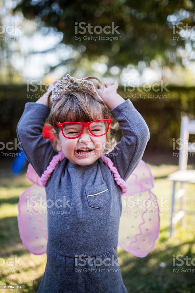 Angry butterfly girl stock photo
