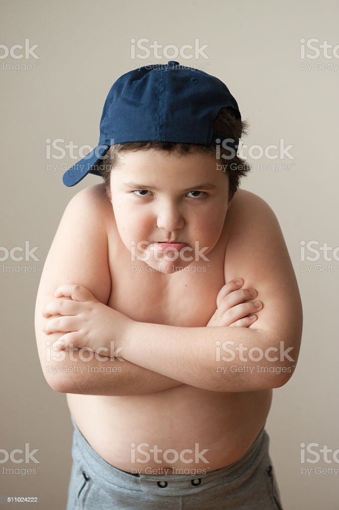 angry child  boy thick aggression hatred fat strong stock photo