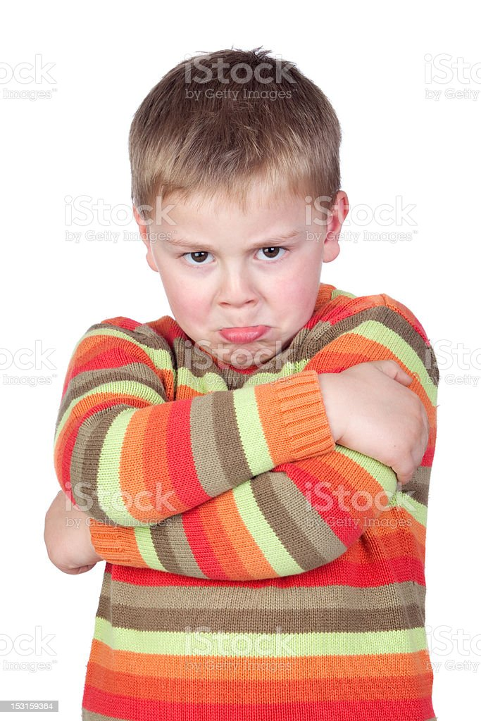 Angry child with crossed arm royalty-free stock photo