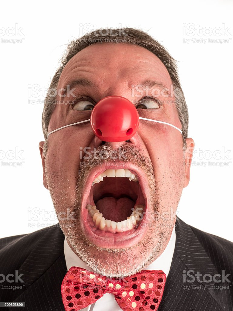 Angry Clown in Suit and Tie Screaming Cross-Eyed. stock photo