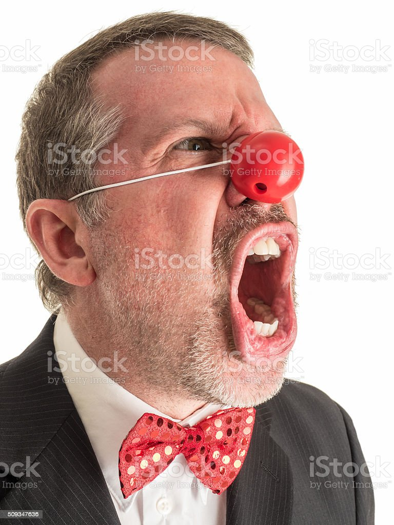 Angry Clown in Suit and Tie Screaming. stock photo
