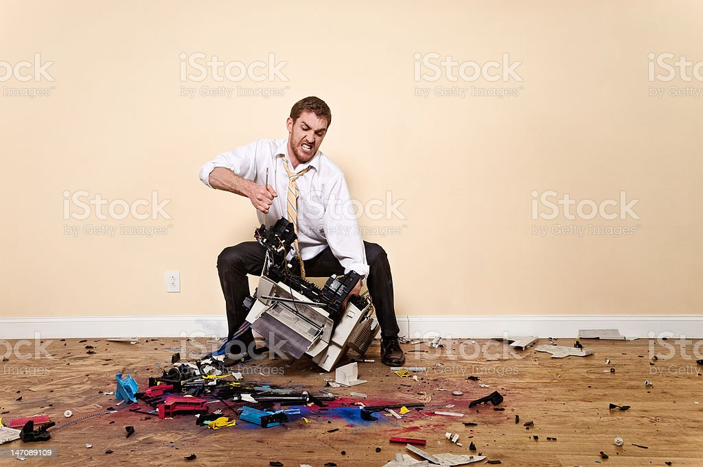 Angry Corporate Man Attacking Printer stock photo