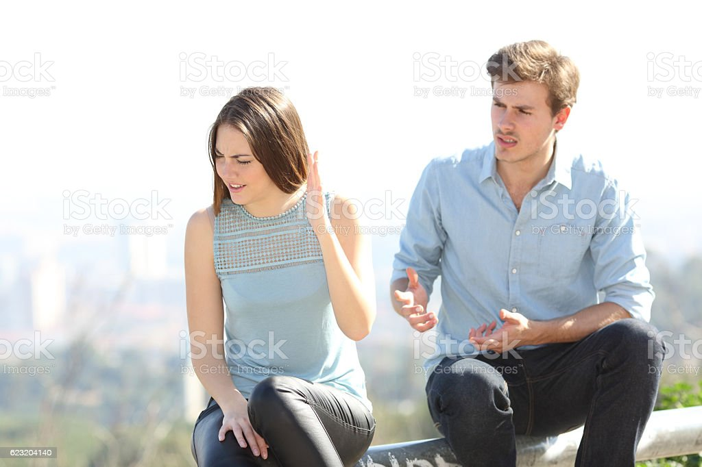 Angry couple arguing outdoors stock photo