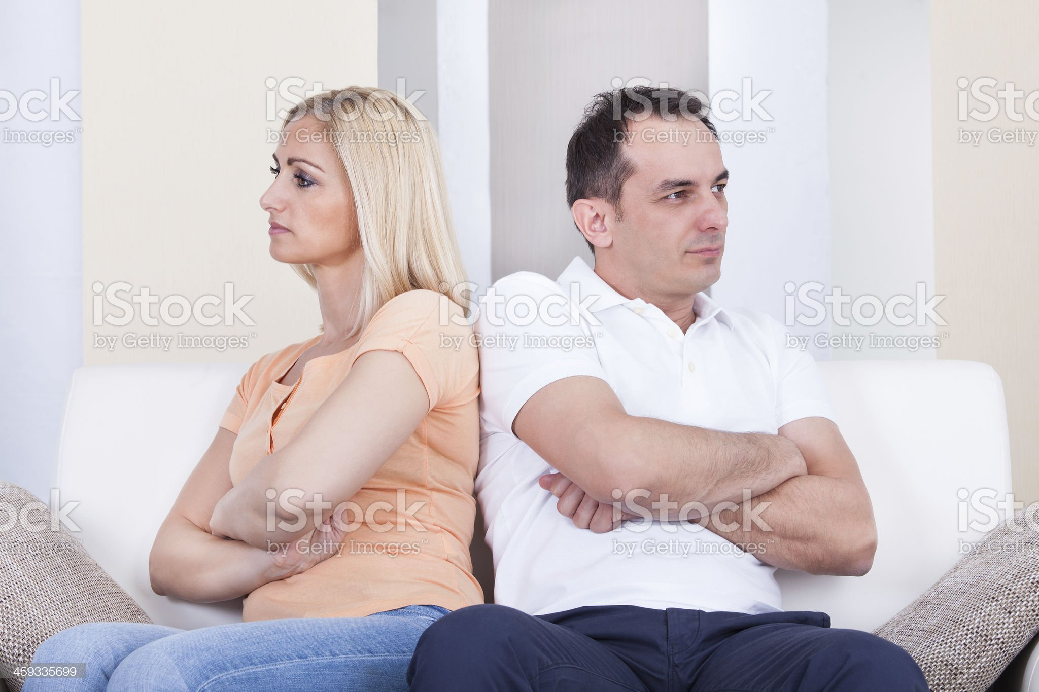 Angry couple sitting on sofa royalty-free stock photo
