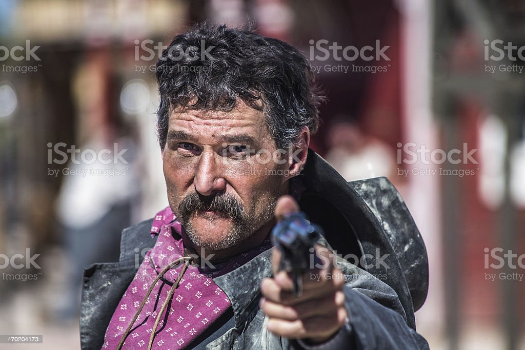 Angry Cowboy With Gun stock photo