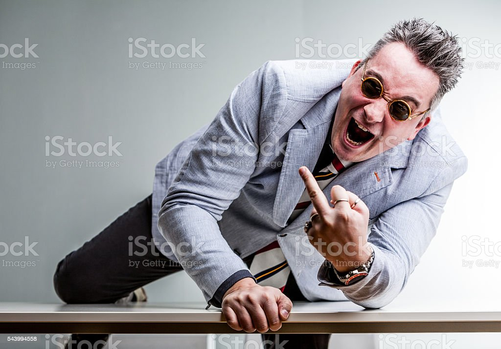 angry crazy businessman showing middle finger stock photo
