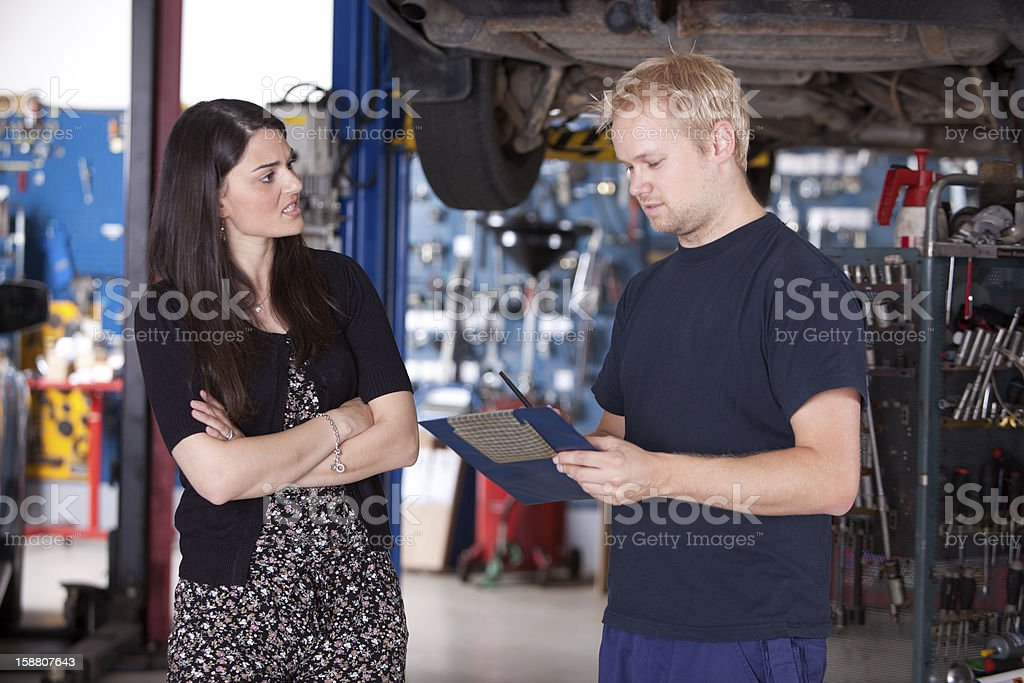 Angry Customer with Mechanic stock photo
