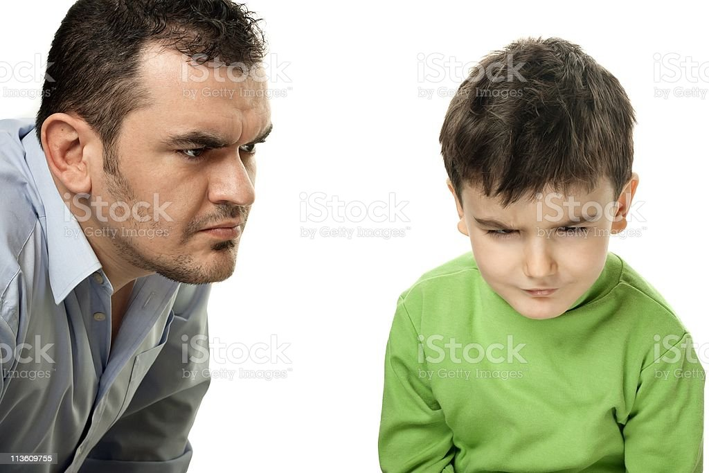 Angry Dad and Offended Child. royalty-free stock photo