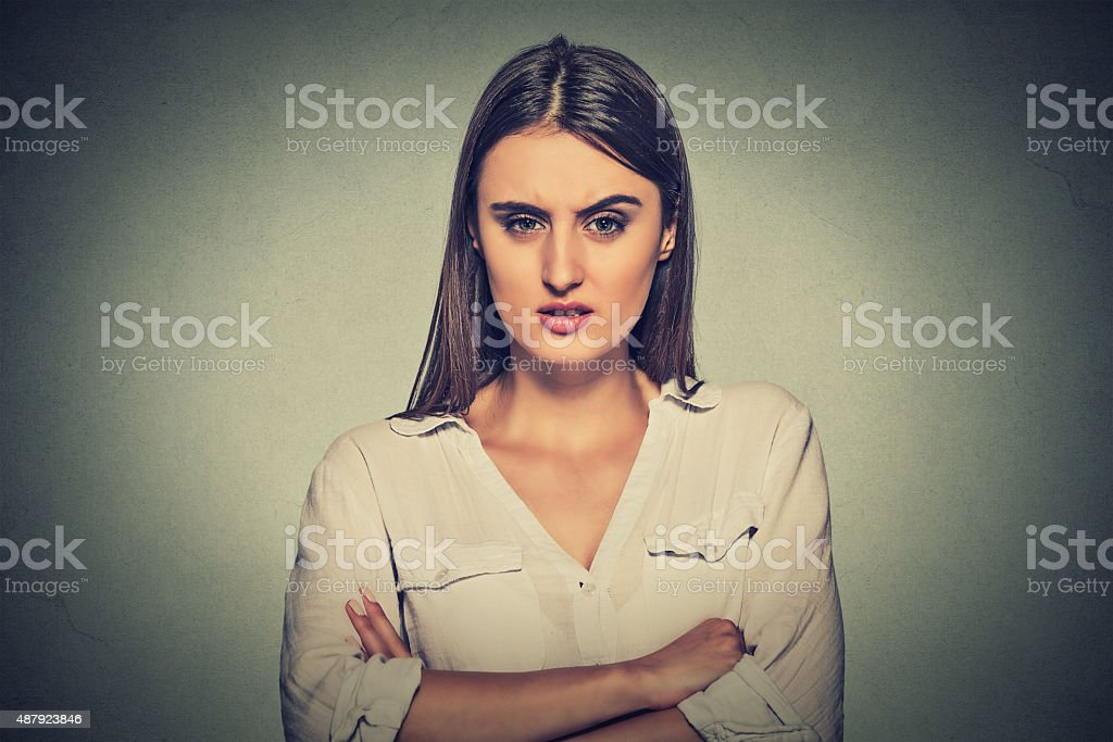 angry displeased woman on gray background stock photo