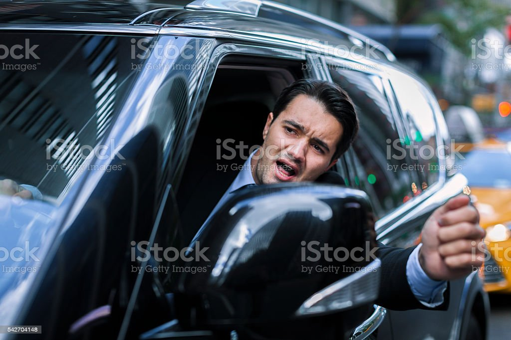 Angry driver in city traffic stock photo