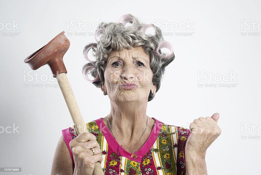 Angry elderly housewife stock photo