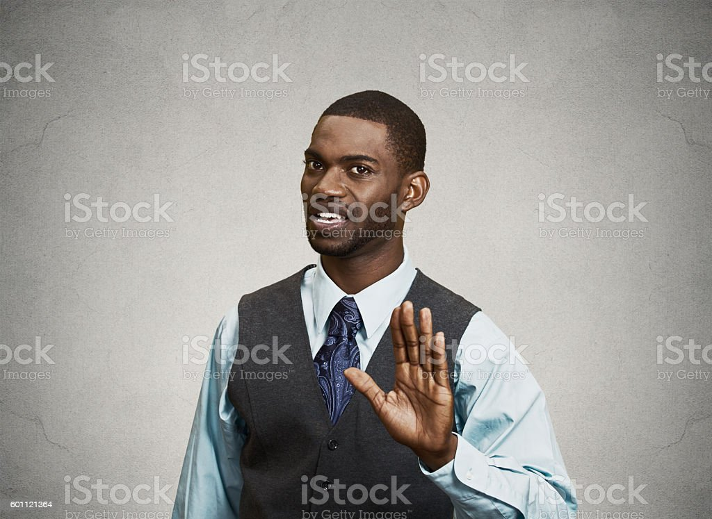 Angry executive gesturing with hands to stop stock photo