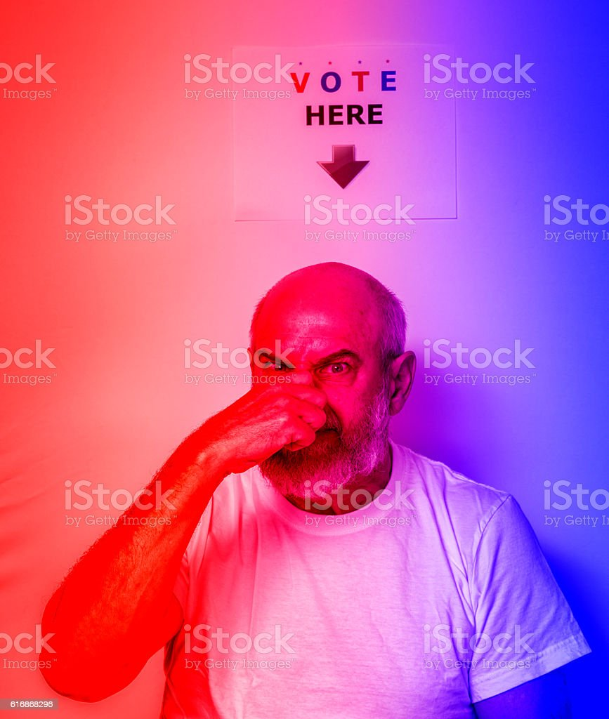 Angry Fed Up USA Independent Senior Man Voter Holding Nose stock photo