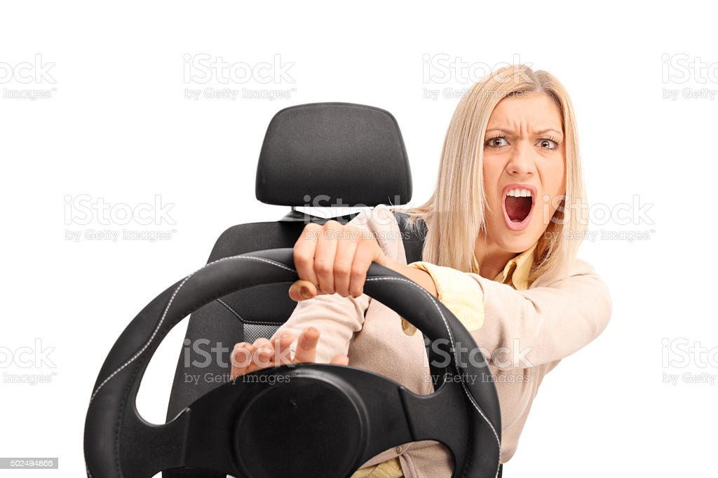 Angry female driver honking on the horn stock photo