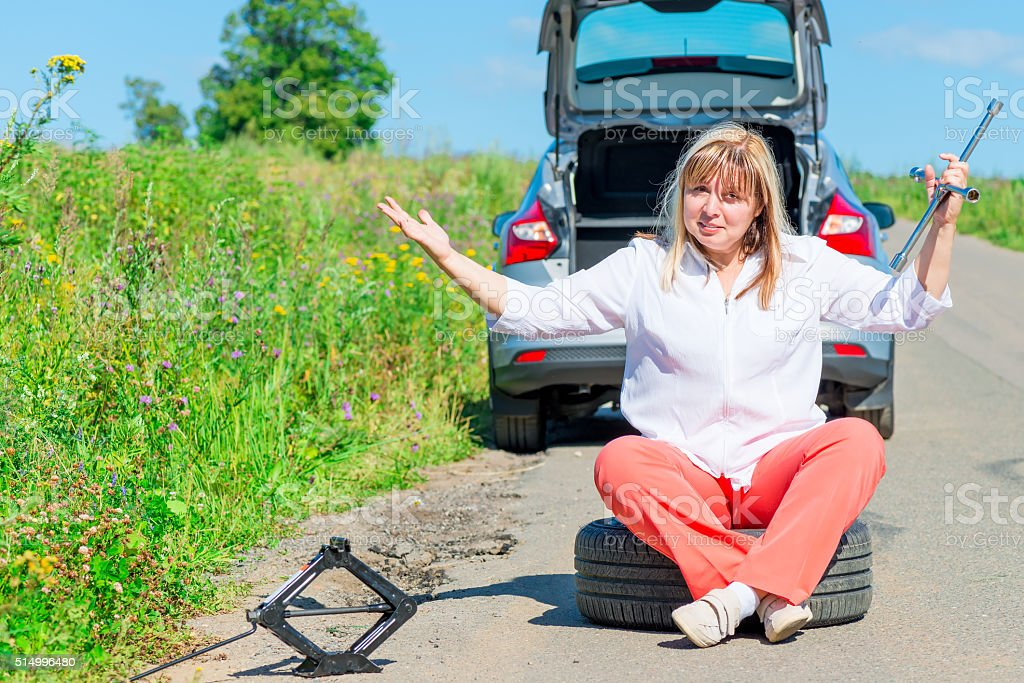 angry female driver sitting at the wheel stock photo