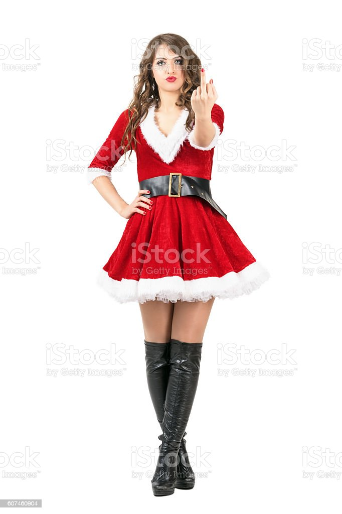 Angry female Santa giving middle finger obscene gesture at camera stock photo