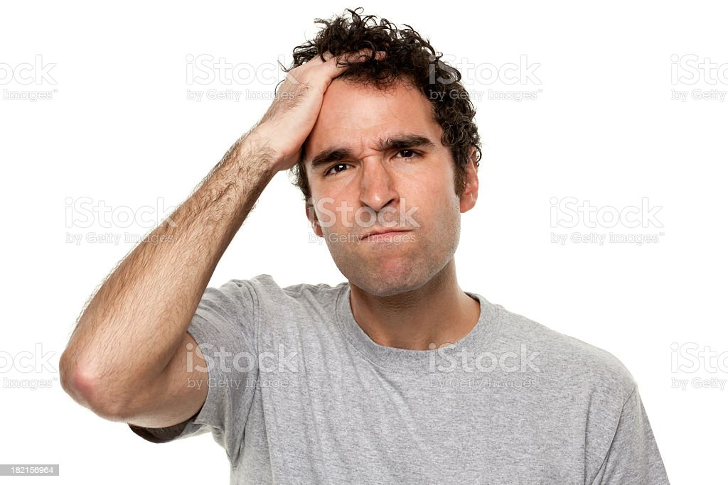 Angry Frustrated Man With Hand In Hair stock photo