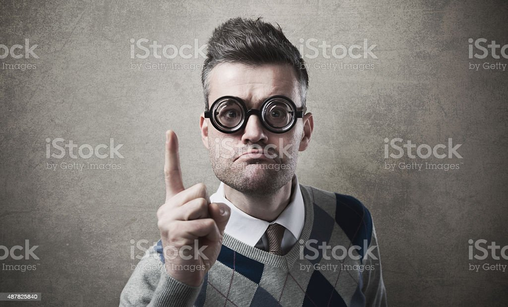Angry funny guy reproaching somebody stock photo