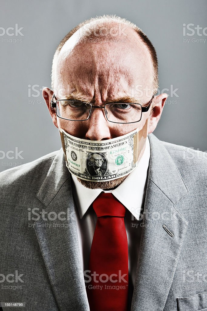 Angry gagged businessman does not want to keep quiet stock photo