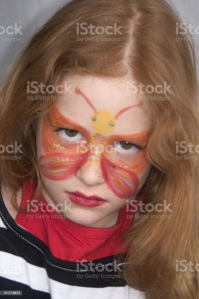 angry girl, child with face painting royalty-free stock photo