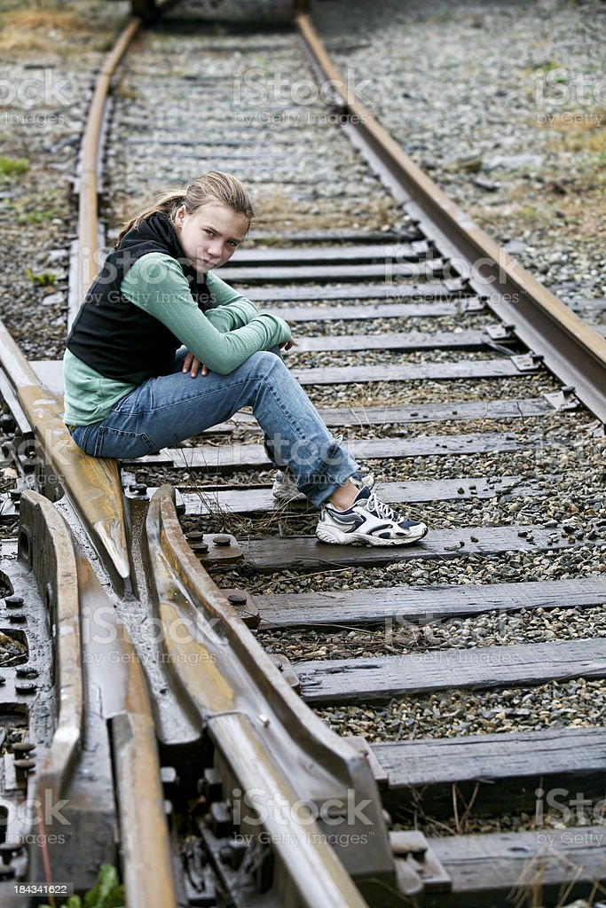 Angry Girl on Railway Tracks royalty-free stock photo