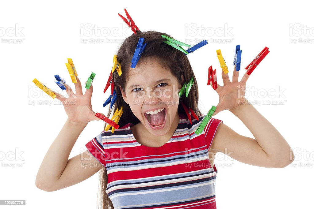 Angry girl with clothespins royalty-free stock photo