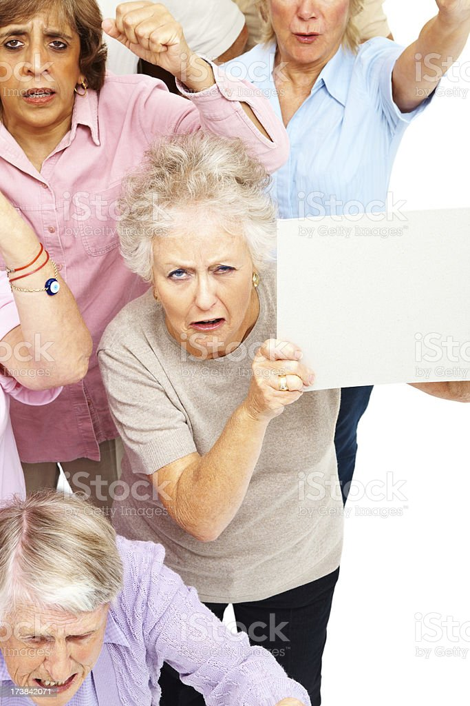 Angry group of old women with sign boards royalty-free stock photo