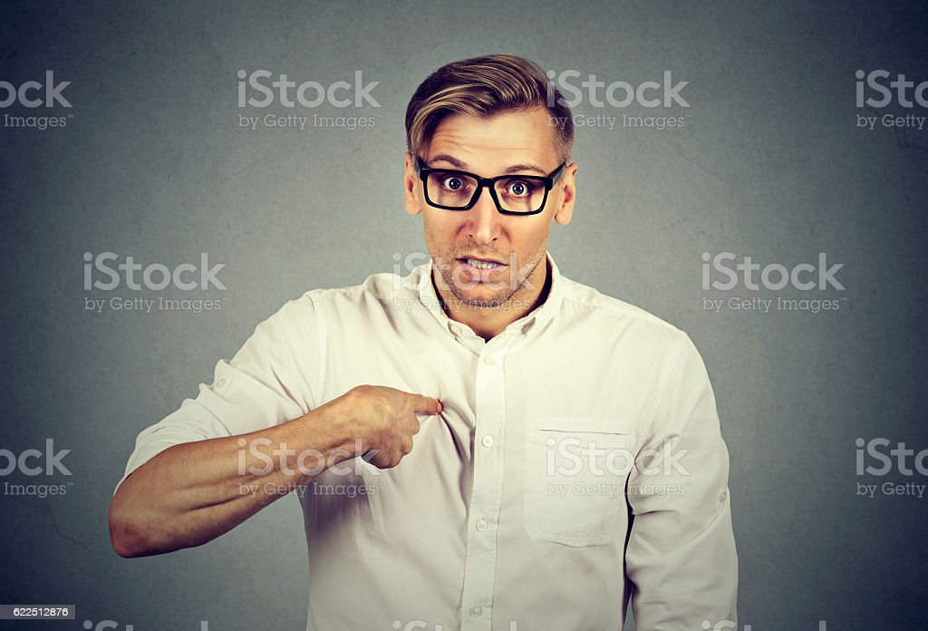 angry guy pointing at himself you mean me stock photo