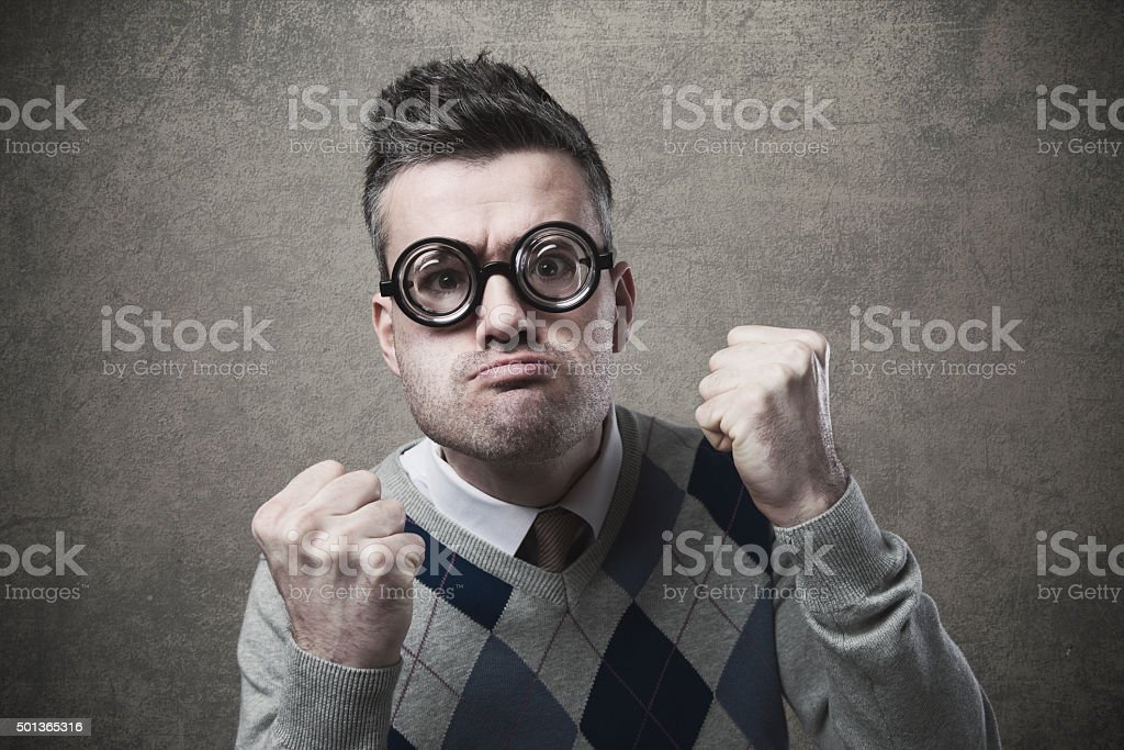 Angry guy with fists raised stock photo