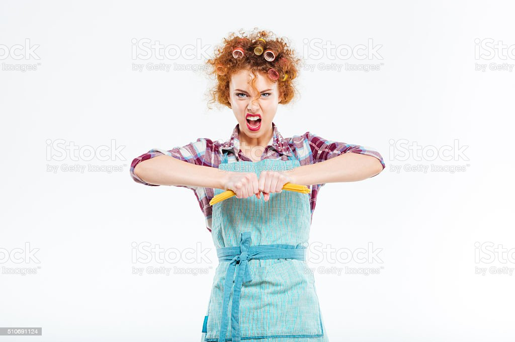 Angry housewife brokes spaghetti stock photo