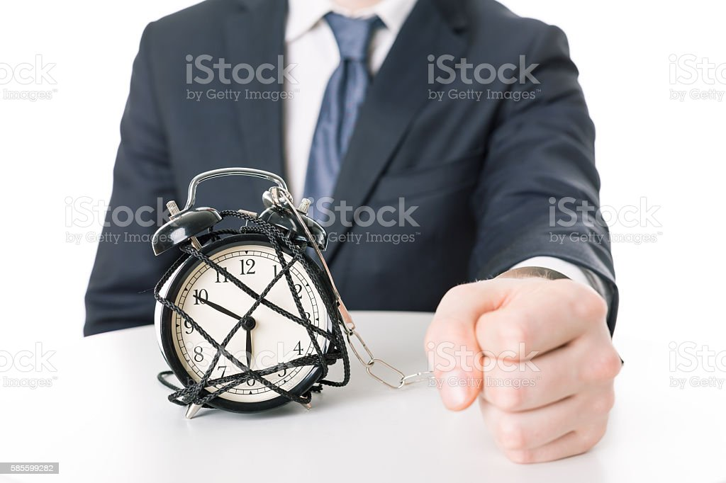 Angry imprisoned man and time pressure stock photo
