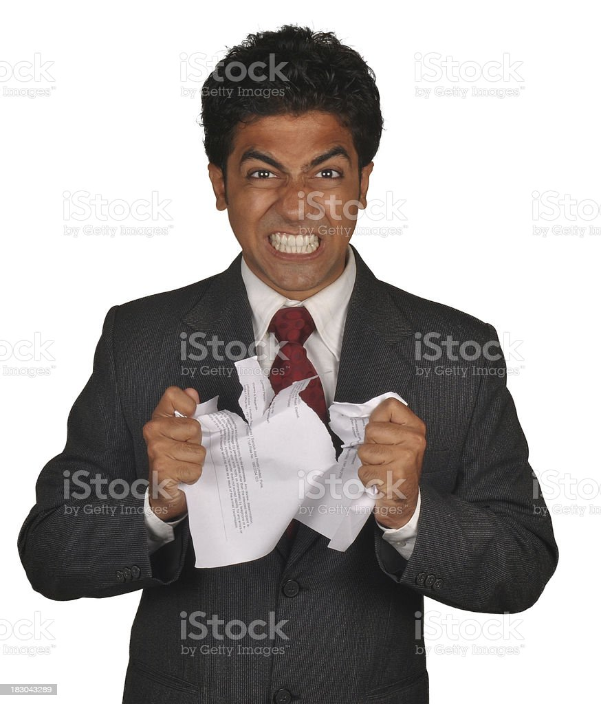 Angry Indian Businessman Tearing Up A Document royalty-free stock photo