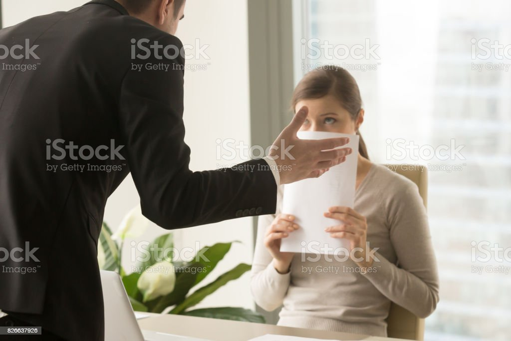 Angry irritated boss reprimanding employee, verbal warning about work failure stock photo