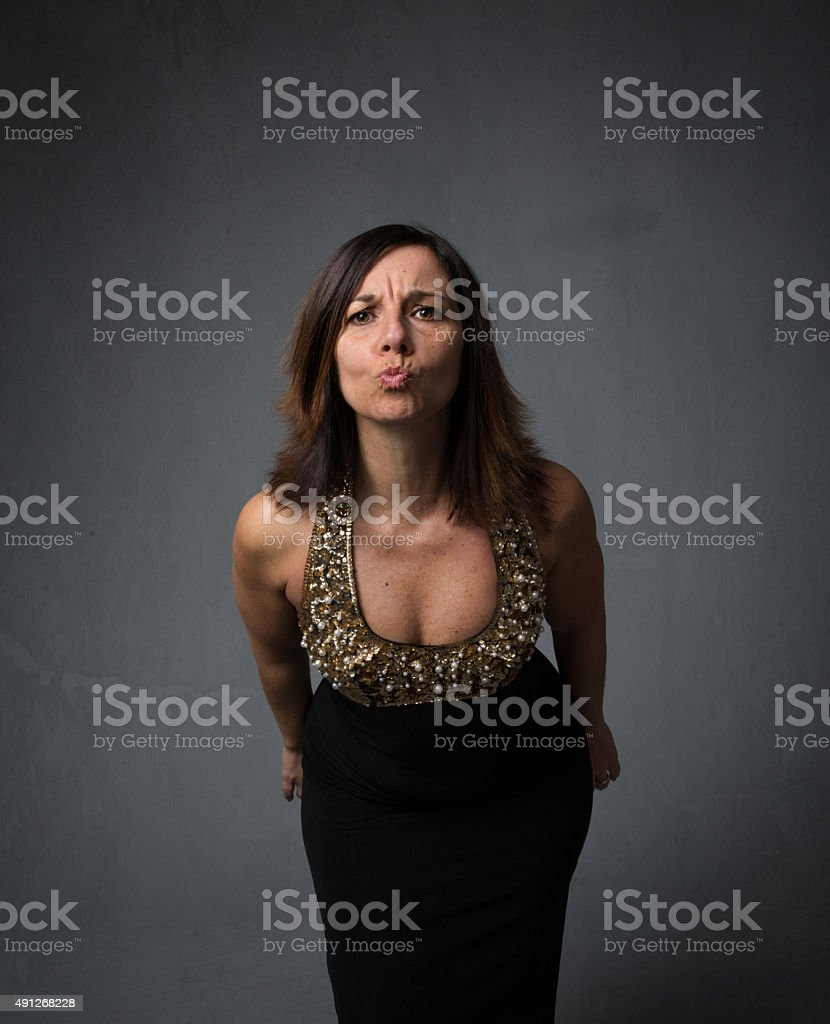 angry lady blowing kisses stock photo
