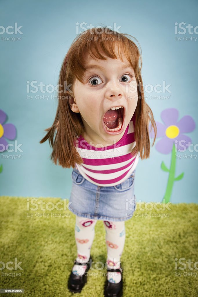 Angry Little Girl, With Red Hair, in Whimsical World royalty-free stock photo
