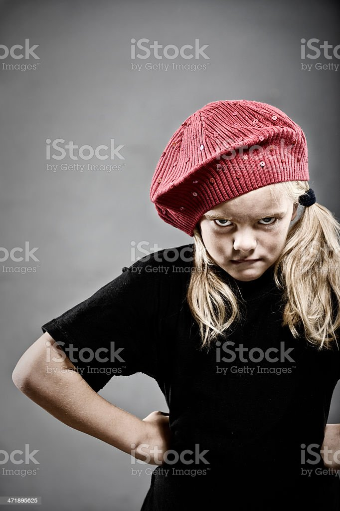 Angry little girl with red hat royalty-free stock photo