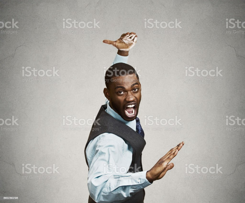 angry mad furious, company man raising hands in air attack with karate chop stock photo