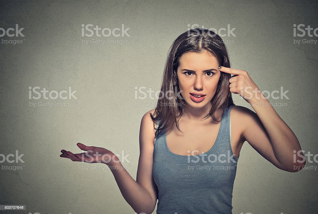 angry mad woman gesturing asking are you crazy? stock photo